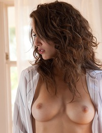 Malena Morgan removes her white shirt