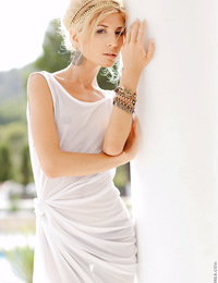 A sexy Stephanie strips off her white dress and shares her hot skinny body