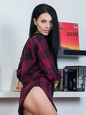 The charming Rafaella, happily posing and teasing on top of bright red sofa, her delectably slender body is such a pleasing view.