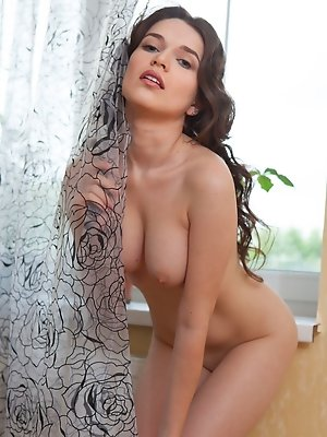 Serena Wood displays her gorgeous body and sweet pussy by the window.