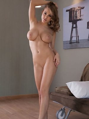 Busty Viola Bailey strips and displays her sexy cury body and delectable pussy in front of the camera.
